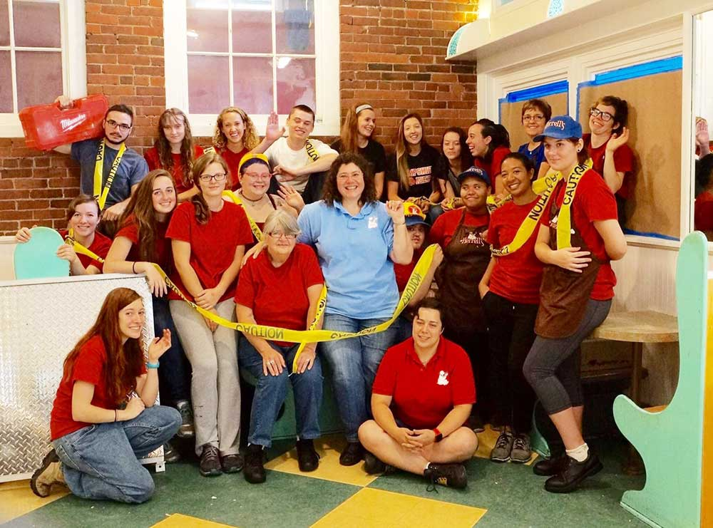 Herrell's® employees with yellow caution tape
